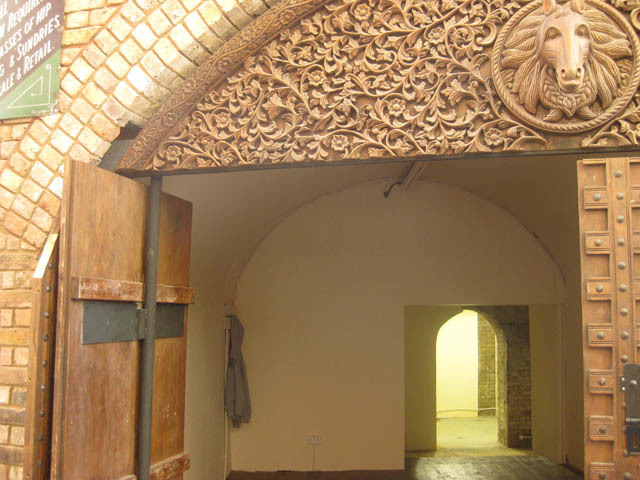 Peering inside one of the new shop units, to the south of the Stables beneath the railway. Note the elaborate wooden carving, reminiscent of the craftwork in the Gilgamesh building.