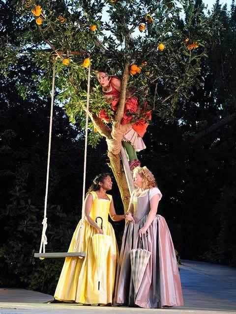 Samantha Spiro (Beatrice) overhears Anneika Rose (Hero) and Sarah Ingram (Ursula) praising Benedick at Regent's Park Open Air Theatre. Photo by Alistair Muir