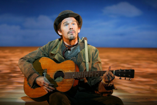Ethan Hawke as Autolycus, strumming his guitar