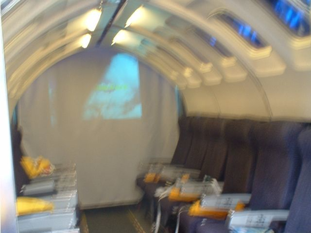 Aircraft cabin interior, blurred not by turbulence but by inept photographer / diner