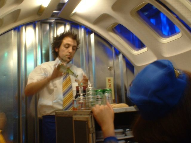 Richard Dedomenici serves drinks from the trolley