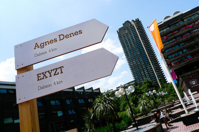 Signposts pointing toward Dalston, where work by Agnes Denes and EXYZT will open in July