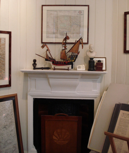 Tim Bryars: beautiful fireplace with an old Tube map hanging in pride of place