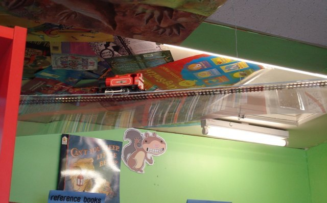 Look! It's a little model railway across the entrance to the children's section. Aw