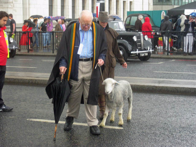 One man and his sheep. An unusual sight, but we're more intrigued by the sinister gentleman behind them.