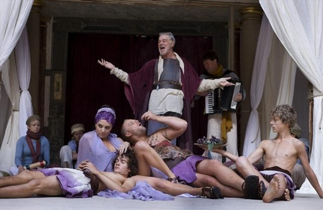 Pandarus (Matthew Kelly) with Paris and Helen and their entourage of cute young boys. Photo by John Tramper