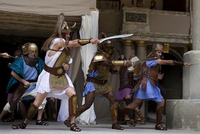Matthew Flynn as Greek warrior Agamemnon fighting with his tough soldiers. In skirts.  Photo by John Tramper