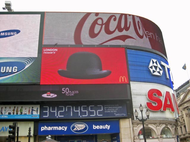 The McDonald's sign throws up a range of images for passers-by to pose in front of. Here's the traditional London bowler hat.