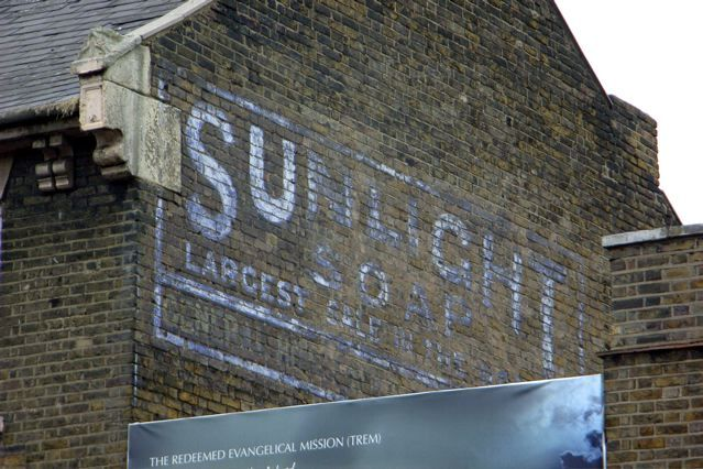 An old advertising sign for Sunlight soap in Upper Clapton Road, E5