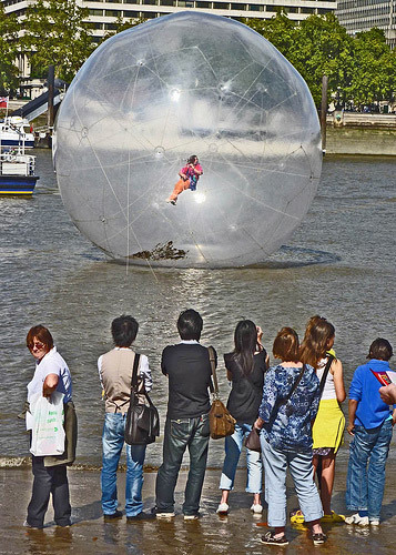 Man playing flute in a bubble (Where The Art Is)