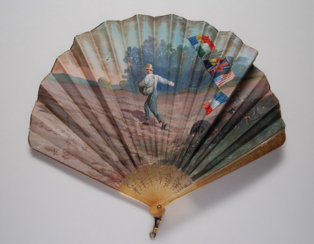 Horn fan, the leaf painted with a man sowing seed in a field still displaying signs of war. Signed van Garden. French, c. 1918/19