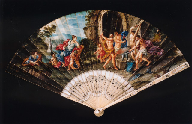 Ivory and mother-of-pearl fan with vellum leaf painted with a scene of Venus watching Vulcan forge weapons. Probably Italian, c. 1700-20