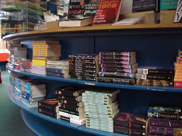 Piles of books by the tills