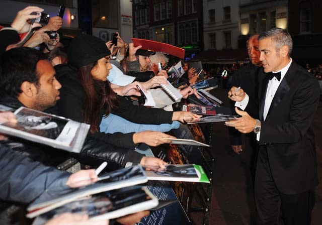 George Clooney signs autographs in Leicester Square