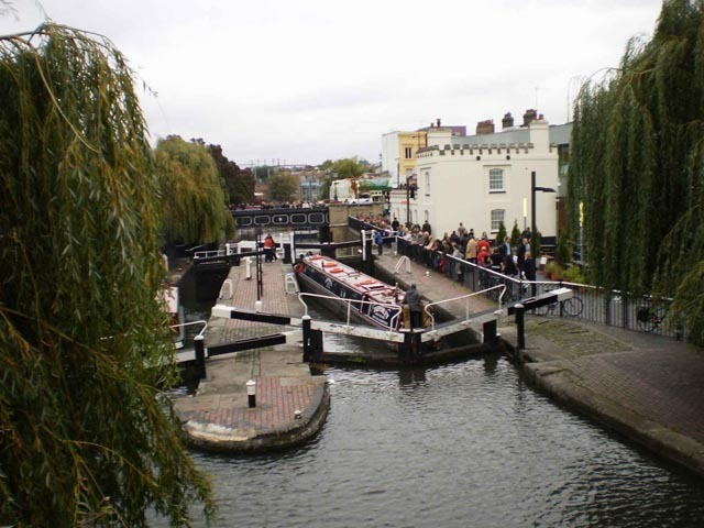 The best views of Camden Locks can be gained from the black arched bridge. Another castellated structure appears to the right - this time a rather attractive branch of Starbucks.