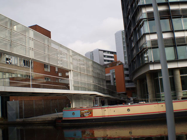 In contrast to the sweeping curve of the water course, the bend where the canal leaves Paddington Basin is a dominated by linear architecture.
