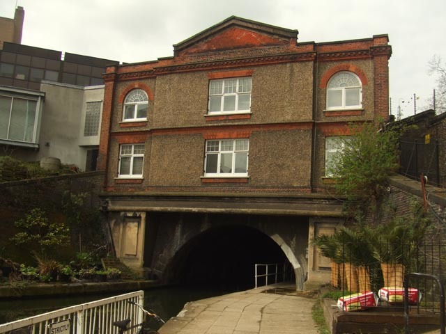 We rejoin the canal near Lisson Grove, where the unusual 'Upside-Down House' straddles the water. From here, the canal sweeps around the northern edge of Regent's Park on a long, leafy stretch. Look out for 'blow-up bridge', which was destroyed by a gunpowder explosion in the 19th Century, killing several boatmen and freeing animals at nearby London Zoo.