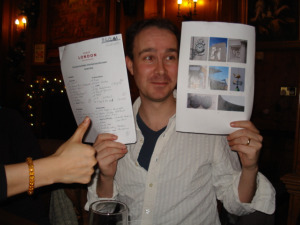 M@ shows off Team Londonist's completed answer sheet