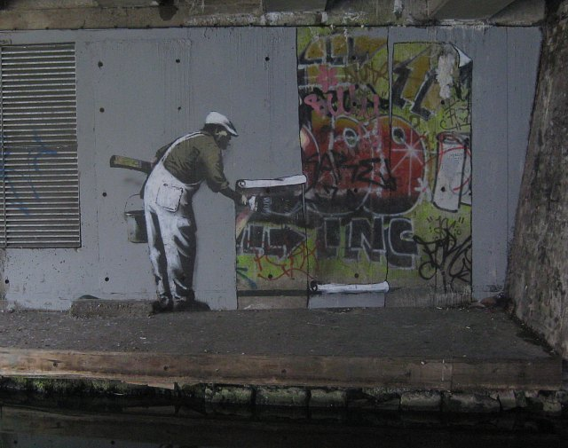 Banksy shuffled up some new art along the Regent's Canal, though it didn't stay unmolested for long M@