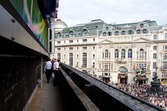 A  rare tour behind (and on top of) the Piccadilly Circus signs; who knew there was a balcony halfway up? DeanN