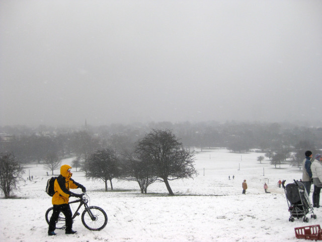 The view from Primrose Hill, whose paths had been salted. To the right of shot, people take turns to sledge down the hill.  M@