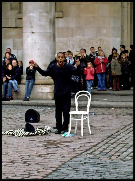 Suspended animation in Covent Garden - a street performer plies his trade.
