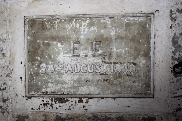 An old plaque near the front entrance marks the foundation date: 1868.