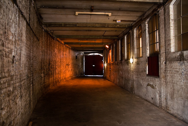 The long passage leading from the road to the main warehouse space.