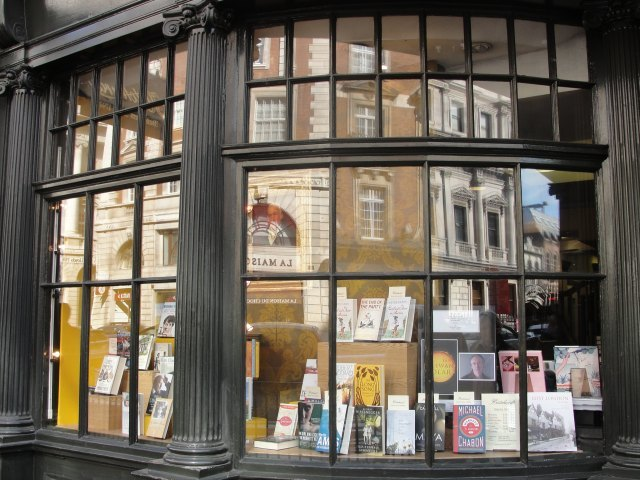 "Hatchards booksellers: ""But what was she dreaming as she looked into Hatchards' shop window?... Ever so many books there were; but none that seemed exactly right to take to Evelyn Whitbread in her nursing home."" (p. 7)"