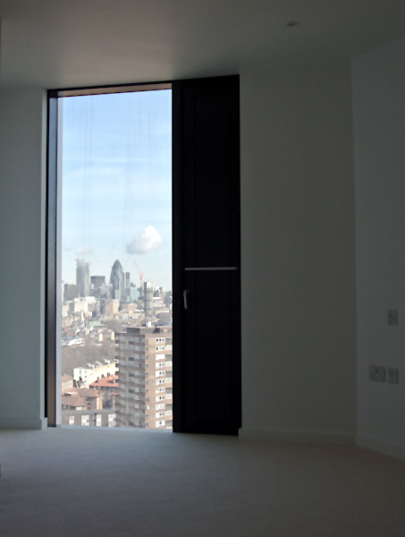 Floor to ceiling windows are standard in all apartments. Although windows cannot be opened, the vertical black strip can be pulled back to allow ventilation. The windows are heavily soundproofed, as is immediately apparent when the ventilation strip is closed.