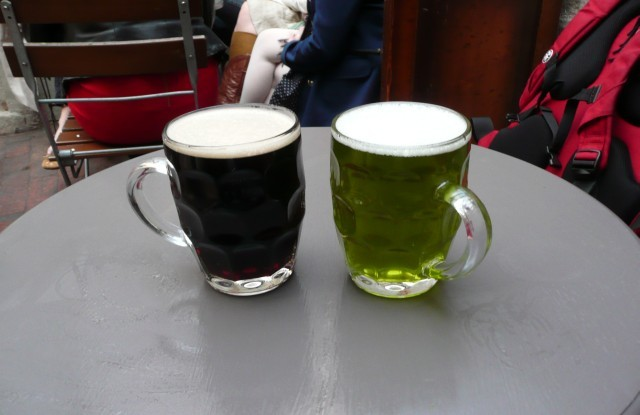 College Garden Brewery Molly's Chocolate Stout next to a pint of washing-up liquid Stonehenge Ales' Sign Of Spring.