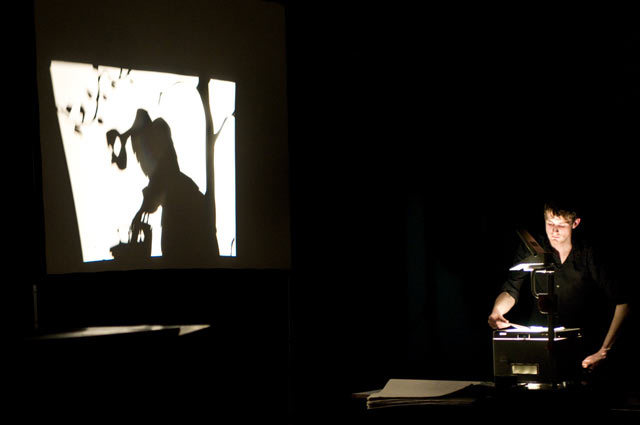 The shadowpuppetry of Matthew Robins' 'Death of Flyboy'. Matthew Robins and band are out of shot on the left.  Alex Muller
