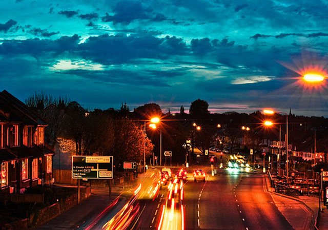 street lights, clouds, traffic lights and the hint of a sunset