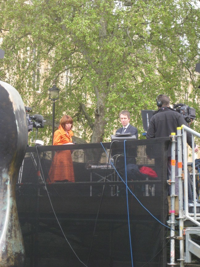 Kay Burley on Sky News' sole, uncovered, platform for the station's marathon coverage. The station's Jeremy Thompson had to get his umbrella out when it started to rain at 5pm.