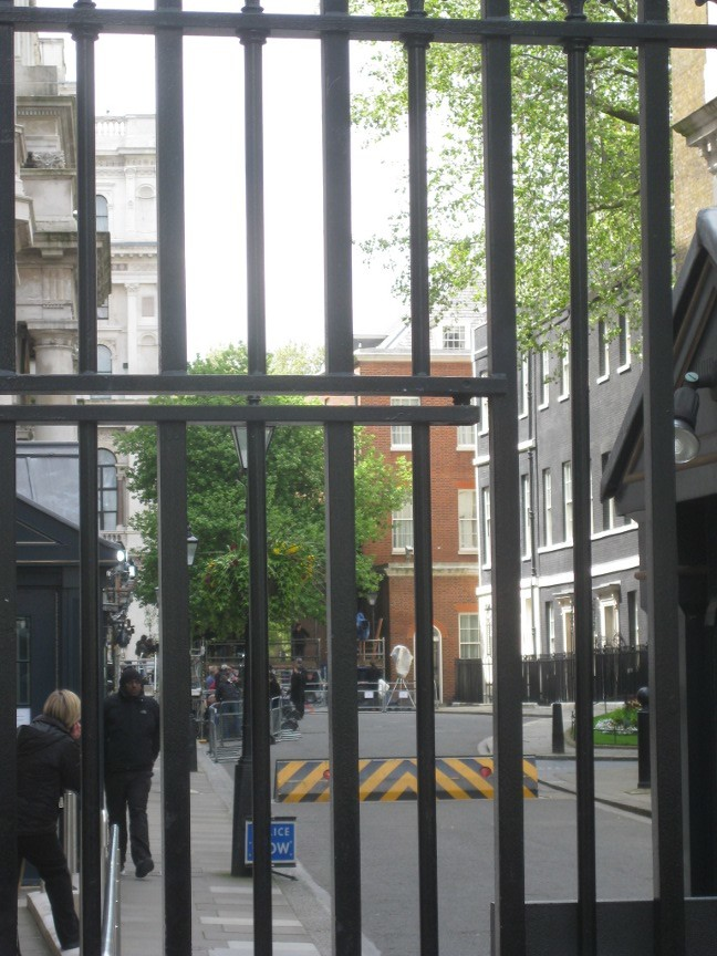 Gates to Downing Street show the press pack awaiting a statement from Gordon Brown