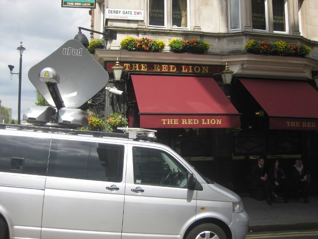 Satellite van outside popular Parliamentary watering hole, the Red Lion.
