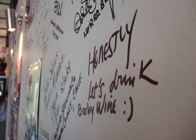 Brewers have scrawled witty dedications on the wall. Photo by Jason B. Standing.