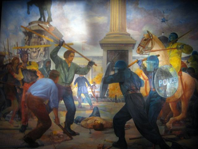 The new galleries are lined with fascinating art work, including this mural of the Trafalgar Square poll tax riots. Image by M@.