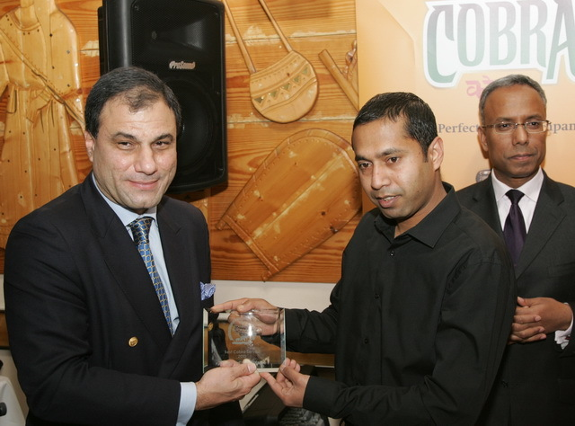 Lord Karan Bilimoria presents the award for (appropriately) the best Cobra served on Brick Lane.