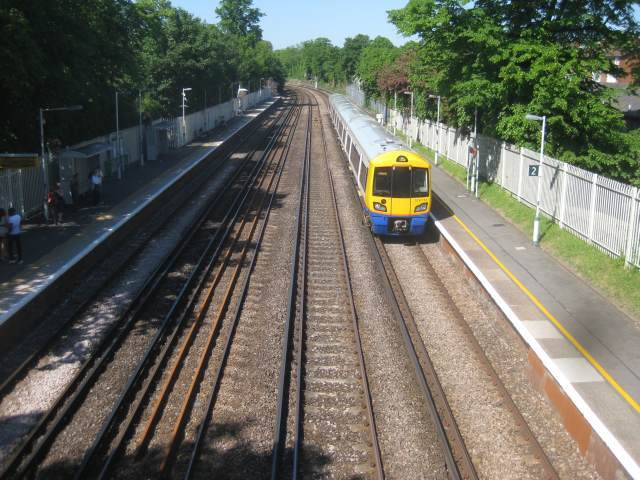A new Overground train pulls into Sydenham station.