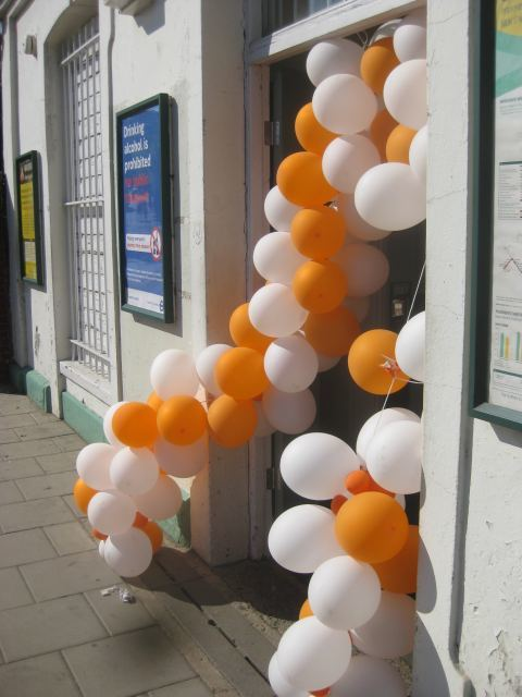 The new stations each had an arch of orange and white balloons to greet passengers.