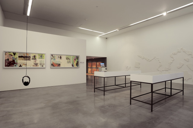 The downstairs room showing various works.