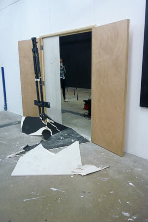 Breaking barriers... literally - the door adjoining the theatre and gallery space smashed through in style
