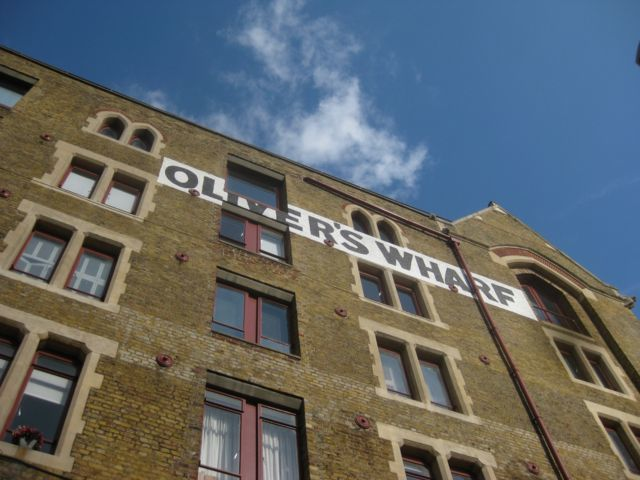 One of the first riverside warehouses to be converted into modern apartments overlooks the site.