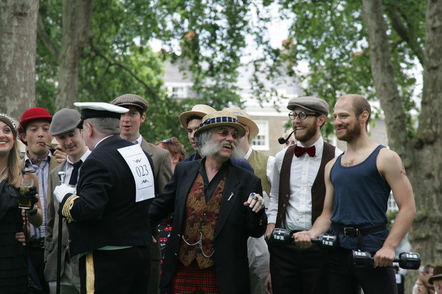 Competitors await their turn to suck upon Mr Temple's pipe.