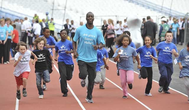 Michael Johnson resisting the urge to beat small children at the 100m