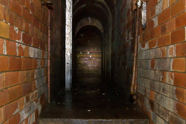 The narrow, raised walkway joining the two branches of the Fleet Sewer.