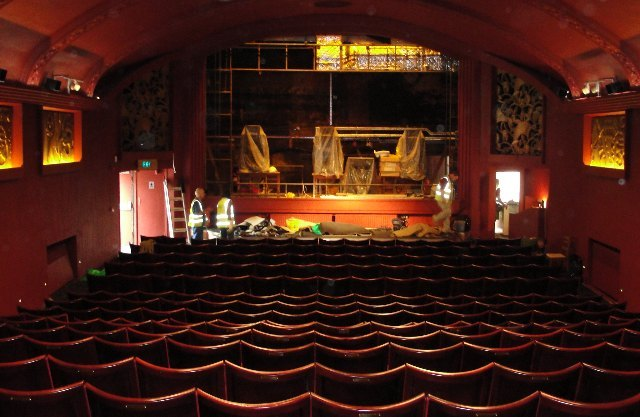 Builders finish off the new stage in the auditorium. The 1910 ceiling has been painted the colour it originally was.