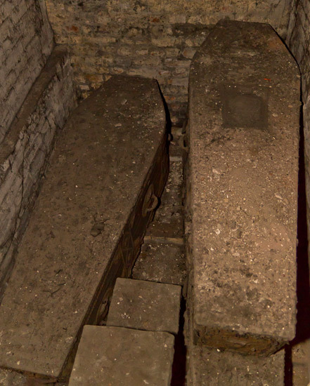 A pair of coffins belonging to the Simpson family; the vicar claimed he'd observed a ghostly apparition in the Church, whom he suspects is from this clan.