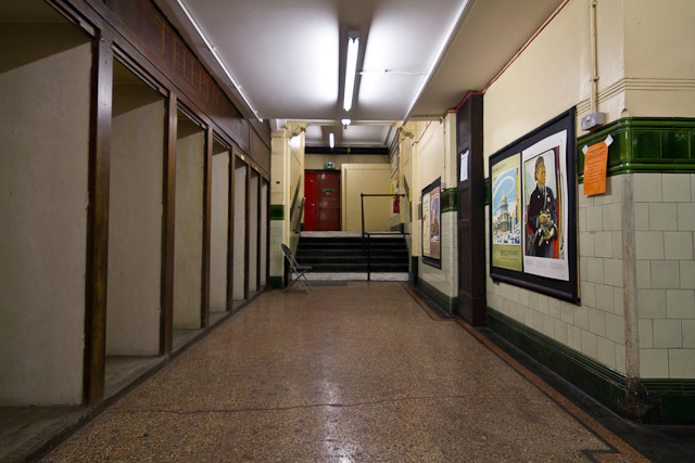 The ticket hall; note period posters on the right.
